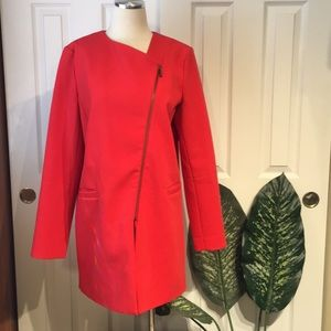 Assymetrical zippered red overcoat by HALOGEN